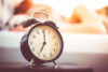 vintage-alarm-clock-and-sleeping-woman_free_stock_photos_picjumbo_DSC03463-1080x720